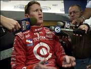Indy Racing League driver Scott Dixon answers questions following practice at the Kansas Speedway in Kansas City Kan.