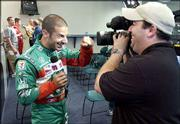 Indy Racing League driver Tony Kanaan horses around for a TV crew. A handful of racers tested cars Tuesday at Kansas Speedway in Kansas City, Kan.
