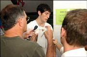 Former Kansas University guard Kirk Hinrich talks to reporters. Hinrich spoke at KU coach Bill Self's basketball camp Tuesday at Horejsi Center.
