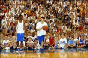 Former Kansas University basketball standout Kirk Hinrich, center, and KU junior-to-be Aaron Miles shoot around for a slew of captivated campers. Hinrich spoke to the youths Tuesday at coach Bill Self's basketball camp at Horejsi Center.