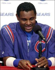 Sammy Sosa speaks at a news conference prior to serving the final game of a seven-game suspension for using a corked bat. Sosa spoke Tuesday in Cincinnati.