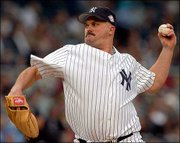 New York's David Wells delivers against Tampa Bay. Wells pitched New York to a 10-2 victory, giving the Yankees a split of their doubleheader with the Devil Rays Tuesday in New York. Tampa Bay won the opener, 11-2.