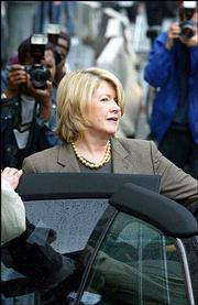 Martha Stewart leaves federal court in New York where she appeared for a status conference. A federal judge Thursday set a Jan. 12 trial date for Stewart, the home decorating and cooking maven who faces charges arising from a stock-trading scandal.