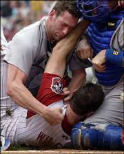 Cubs pitcher Kyle Farnsworth, left, punches Cincinnati's Paul Wilson as catcher Damian Miller tries to pull them apart. Farnsworth and Wilson were ejected during the Reds' 3-1 victory Thursday in Cincinnati.