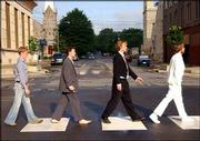 "Lawrence&squot;s hardaways re-create the famous 1969 album cover to The Beatles&squot; ""Abbey Road"" in front of The Replay Lounge at 10th and Mass."