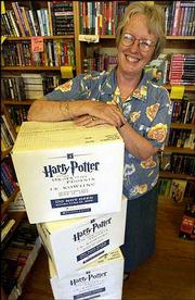 "Pat Kehde, co-owner of the Raven Bookstore, 8 E. Seventh St., is like bookstore owners all across the country who must wait until midnight to open cartons of ""Harry Potter and the Order of the Phoenix."" The fifth book in the series goes on sale at midnight today."