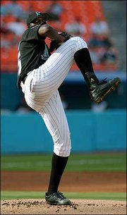 Florida's Dontrelle Willis pitches against Cincinnati last month in Miami. A year ago, Willis was at the lowest level of organized baseball, playing for the Class-A Greensboro Bats of the South Atlantic League. Now the 21-year-old rookie left-hander is adjusting to the possibility that he might be among game's brightest young stars.