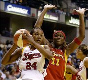 Fever forward tamika catchings (24) pulls down a rebound against Connecticut's Taj McWilliams-Franklin. Indiana beat the Sun, 84-74, Friday in Indianapolis.
