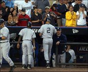 Fans at shea stadium cheer as the Yankees' Derek Jeter (2) is greeted by David Wells after hitting a solo home run. The visiting Yankees shut down the Mets, 5-0, Friday night in New York.