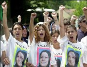 Supporters of the Iranian opposition group the Mujahedeen Khalk protest at the group's headquarters north of Paris. Militants, wearing T-shirts with a portrait of the group's co-leader Maryam Rajavi, Monday protested last week's crackdown on the group and demanded Rajavi's release.