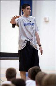 Nick Collison talks to players at Kansas coach Bill Self's basketball camp. Collison, a former Jayhawk and future NBA player, was helping with the camp Monday in the Horejsi Center.