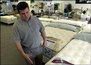 James Hill, owner of Sleepy Sheep Mattress Co. , 2223 La., worries his small store won't be able to financially deal with changes in how the state is requiring businesses like his to collect sales taxes. The new law, which will affect companies that deliver their products, begins July 1.