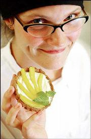 Alison Olewnik, pastry chef and baker at Community Mercantile Co-op, 901 Iowa, displays a mango cream tart with french cream and whole wheat crust. Olewnik, the youngest graduate of the American Institute of Baking in Manhattan, hopes to transform Mercantile's bakery into a sell-all, do-all pastry shop.