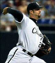 Chicago's Esteban Loaiza delivers against Minnesota. Loaiza allowed one run in eight innings as the White Sox defeated the Twins, 2-1, Tuesday in Minneapolis.