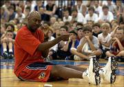 Former Kansas University All-American Danny Manning talks to youths at coach Bill Self's basketball camp. Manning gave campers tips on improving their basketball skills Tuesday at Horejsi Center.