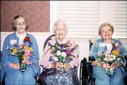 Countryside Garden Club members Mary Lou Humphrey, Mary Allen and Marge Smith display flower arrangements at a recent C ountryside Garden Club meeting. The club has been meeting monthly for 50 years.