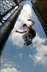 Zac Fesler, 15, kick-flips his skateboard off the halfpipe at the skate park in Lawrence's Centennial Park. The skate park was built to give skateboarders their own venue and to keep them off of public and private properties. But skateboarders say that while the park is nice, the street is the best place to learn their craft. Fesler was at the park earlier this month.