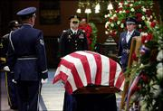 The body of former Sen. Strom Thurmond, R-S.C., lies in state in the rotunda of the South Carolina Statehouse surrounded by members of the Army and Air National Guard in Columbia, S.C. Sunday's service honored the longest-serving U.S. senator in history.