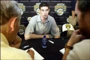 Nick Collison talks to reporters during a news conference. Collison, one of the Sonics' first-round draft picks, was introduced to the media Monday at Seattle.