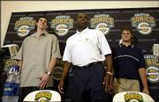 Seattle draft picks Nick Collison, left, and Luke Ridnour, right, stand with SuperSonics coach Nate McMillan. They attended a news conference Monday at Seattle. Collison and Ridnour were selected in the first round of the NBA draft.