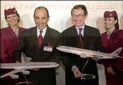 Qatar Airways chief executive officer Akbar AL Baker, second left, shares a laugh with Airbus chief executive officer Noel Forgeard after a joint press conference at the Paris Air Show at Le Bourget airport. Qatar Airways signed for the acquisition of 18 Airbus aircraft including several A380 super jumbo jets, worth $ 5.1 billion. The deal was signed June 19 during the air show.