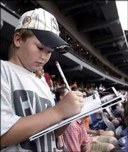 Joey Fermin, 10, keeps score at U.S. Cellular Field. Fermin attended the White Sox-Twins game July 1 in Chicago.