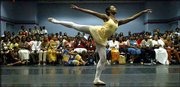 Aisha Mitchell performs during the annual dance competition at the 2003 National Association for the Advancement of Colored People's convention at the Miami Beach Convention Center in Miami Beach, Fla. Some of the Democratic presidential candidates plan to speak at the convention.