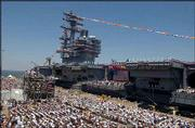 The USS Ronald Reagan aircraft carrier is commissioned at Norfolk Naval Base, Va. The carrier, nearly 1,100 feet long and standing 20 stories above the waterline, is the first to be named for a living president. The flight deck covers 4.5 acres.