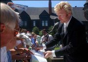 Boris Becker signs autographs after his Tennis Hall of Fame induction. Becker was honored Saturday in Newport, R.I.