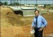 Bob Clark, vice chancellor for the Kansas University Edwards Campus, says the second building at the Overland Park campus, Regnier Hall, will double enrollment within five years of its opening. The Edwards Campus celebrates its 10th anniversary this year. Clark was pictured last week in front of the Regnier Hall construction site.