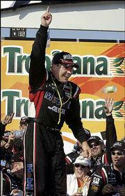 Ryan Newman celebrates his victory in the Tropicana 400. Newman won the NASCAR race Sunday in Joliet, Ill.