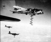 B-17 Flying Fortresses are seen as they drop their bombs over German communication lines at Chemnitz, near Dresden, on Feb. 6, 1945. A B-17 will be on display at Lawrence Municipal Airport this weekend.