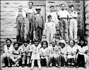 Bob Dole, second from right in the uppermost row, is pictured with his fourth-grade class in Russell.
