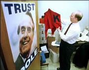 Bryan Culp, Dole archivist at Kansas University's Spencer Research Library, looks at Bob Dole's KU letter sweater in 1998. The former Kansas senator's mementos and papers were housed temporarily at the library before the collection was moved to the Dole Institute of Politics.