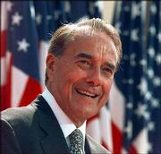 Kansas' longtime U.S. Sen. Bob Dole will come home to Kansas this weekend to take part in ceremonies opening the Dole Institute of Politics. He's shown here during a rally at the 1996 Republican National Convention, where he was nominated for president.