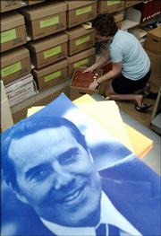 Robyn Conaway boxes up congressional records that span Bob Dole's political career. Kansas University archivists in June moved thousands of boxes of Dole documents and memorabilia from the Spencer Research Library to their permanent home in the Dole Institute of Politics.