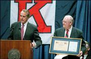 Being named a patron of the KU Friends of the Library is just one of many bonds built between Bob Dole, left, and Kansas University through the years since Dole enrolled at the university. Dole's patron status was made official by KU Chancellor Robert Hemenway, right, during a 1997 visit to campus by the former senator.