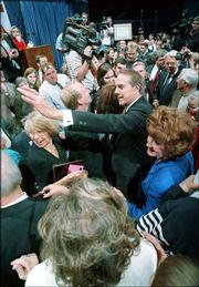 "Former Sen. Bob Dole and his wife, Elizabeth, mingle in the crowd at the ""Tribute to Sen. Bob Dole"" at Allen Fieldhouse on the Kansas University campus. The June 1997 event marked Dole&squot;s first return to Kansas after he was defeated by Bill Clinton in the 1996 presidential election."