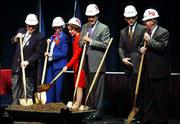 Breaking ground for the new Dole Institute of Politics at Kansas University are, from left, institute director Richard Norton Smith, KU benefactor Polly Bales of Logan, Elizabeth Dole, former Sen. Bob Dole, Gov. Bill Graves and KU Chancellor Robert Hemenway. The 1999 ceremony was at the Lied Center, next door to the site of the institute.