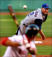 Toronto's Roy Halladay delivers to Boston's Nomar Garciaparra. Halladay won his 14th straight decision as the Blue Jays defeated the Red Sox, 5-2, Thursday night in Boston.