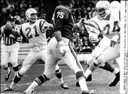 Former Kansas University standout John Hadl (21) heaves a pass as quarterback of the San Diego Chargers in this file photo. With the Chargers, Hadl played behind Jack Kemp, who became a politician and will attend the Dole Institute of Politics opening celebration next week.