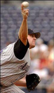 Arizona's Curt Schilling pitches against the Padres. Schilling and the Diamondbacks won, 9-1, Thursday in San Diego.