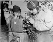 Two American Indian code talkers, members of the U.S. Marines, relay orders in 1943 in the South Pacific.