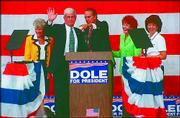 Jack Kemp, left, and Bob Dole campaign in the 1996 presidential race. Kemp, a former professional football player and congressman, was Dole's vice-presidential running mate. Kemp is scheduled to attend the dedication of the Dole Institute of Politics.
