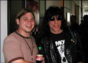 Johnson shares a laugh with Ramones drummer Marky Ramone at the Rock 'N' Roll Fantasy Camp.