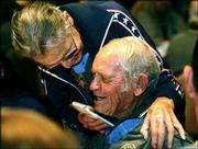 World War II veteran Desmond Doss, left, a conscientious objector who served as a medic during the war, jokes with fellow Congressional Medal of Honor recipient John Finn during a mayor's banquet honoring the medal recipients in Shreveport, La., Sept. 10, 2002. Doss is scheduled to attend this weekend's dedication of the Dole Institute of Politics.