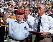 Medal of Honor winner Jack H. Lucas, left, waves to the crowd during halftime ceremonies at the Southern Mississippi football game against Army, Oct. 16, 1999, in Hattiesburg, Miss. Lucas, a private first class during World War II when he received the medal, was presented with a plaque by USM President Horace Fleming, right, and Hattiesburg Mayor Ed Morgan, background center. Lucas is scheduled to attend the dedication of the Dole Institute and speak at the Memory Tent.