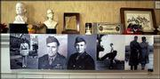 "Samples of the hundreds of photographs of World War II veterans that will hang on the ""Memory Wall"" in the Dole Institute of Politics are displayed on a mantle in the temporary offices of the institute at 12th and Indiana streets."