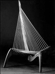 This is a chair made of rope and wood. It was designed by a Danish furniture maker in 1968. The unusual and possibly uncomfortable chair sold for $2,300 at a spring auction by David Rago.