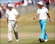 England's Mark Roe, left, and Sweden's Jesper Parnevik walk to the 18th green to finish the third round of the British Open. Roe and Parnevik were disqualified after keeping each other's score on the wrong scorecards Saturday at Royal St. George's in Sandwich, England.